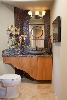 Free form cabinet, the granite is Aurora Borealis, the Zen vessel sink is black granite with a chiseled edge. The accent mirror floats in the middle of the full length mirror.