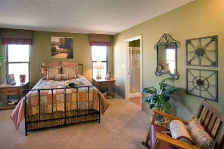 Simple Arts & Crafts style accents this Guest Bedroom Model Home.