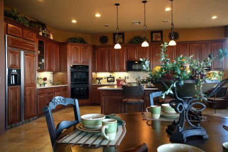 Warm and welcome touches complete this Country Style Model Home Kitchen.