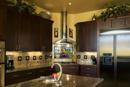 Hand painted custom tile mural reminds the homeowner of wine country.