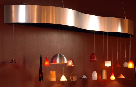 Bent metal Cloud Canopy houses a variety of pendant lights.
