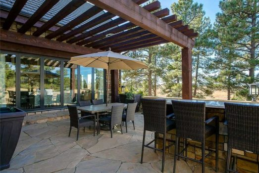 Woodard patio furniture completes this Colorado outdoor area.