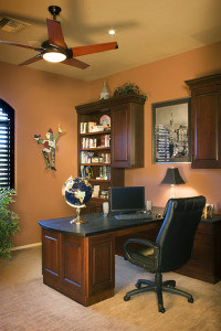 Points of interest are the contemporary fan, built in island desk and walnut shelving which provides organized space.