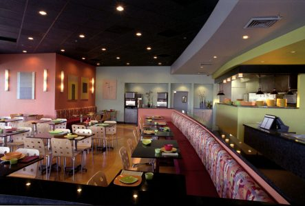 The custom bench seating is comfortable and will accommodate many hungry customers.