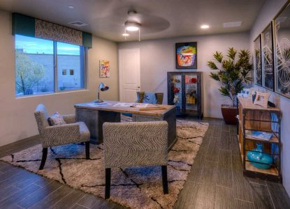 """Den/Study has wood look alike porcelain tile floor, cozy textured area rug, bicycle themed decor superimposed again the paint called """"Industrial Age""""."""