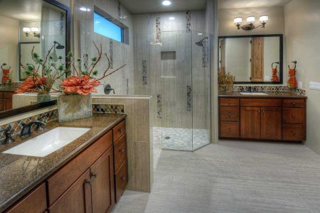Master Bathroom features glass wave tiles in multi color.