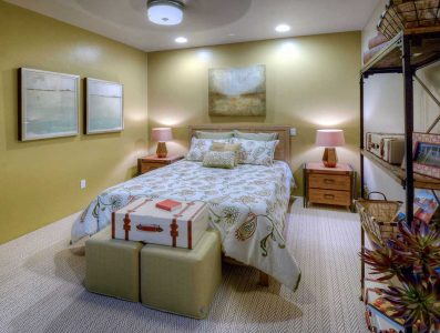 This lovely room sports a travel theme to go along with the Den/Study elements. It is simple yet fun and has a variety of textures and materials integrated into the space. The paint color chosen for the two walls is Dunn Edwards Sunbaked Adobe, classic color for the area, and makes it cool and cozy.