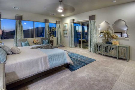 Master Bedroom is simple and soft with a variety of textures and materials. The cool tones provide a calm, relaxed atmosphere. The wall color is Barnwood Gray.